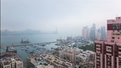 Hong Kong in smog overlooking the port Motion timelapse Stock Footage