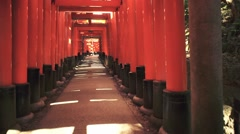 POV walk through the famous orange gates at Fushimi Inari Shinto shrine in Kyoto Stock Footage