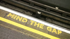 Stock Video Footage of Famous Mind the Gap sign at the underground station in London