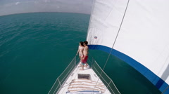 Couple standing in sailing boat Stock Footage