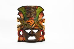 Indian Mayan Aztec wooden mask with anaconda and jaguar isolated on white - stock photo