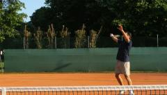 Man playing tennis comes to net and smashes 4k Stock Footage