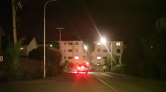 Driving in upper class secured neighborhood at night, Nairobi, Kenya, Africa Stock Footage