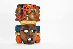 Stock Photo of Indian Mayan Aztec wooden painted mask with roaring jaguar and human profiles
