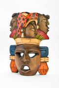 Indian Mayan Aztec wooden painted mask with roaring jaguar and human profiles - stock photo