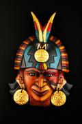 Indian Mayan Aztec ceramic mask isolated on black Stock Photos