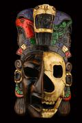 Mexican Mayan Aztec ceramic painted mask with skull isolated on black Stock Photos