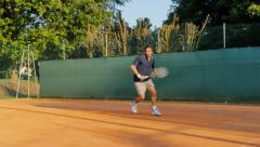 man playing tennis hitting backhand 4k - stock footage