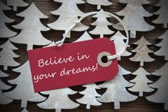 Red Christmas Label With Believe In Your Dreams - stock photo