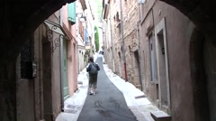 Walking up street in Pezenas, Languedoc, France Stock Footage