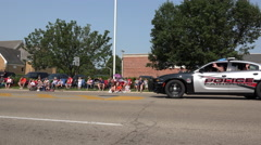 Police car goes by in Fairborn July 4th Parade 4k Stock Footage