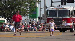 Parade going through streets for 4th of July celebration 4k Stock Footage