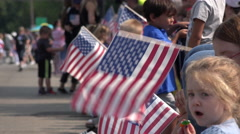July 4th crowd waiting for parade with flags 4k Stock Footage