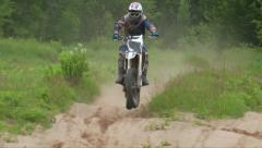 Dirt bike over whoops section Stock Footage