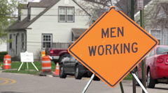 Men working sign in construction area of neighborhood 4k Stock Footage