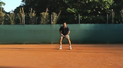 Man playing tennis hitting forehand slow motion Stock Footage