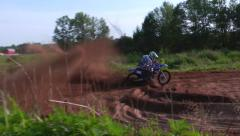mx racer tearing up track and flying over jump - stock footage