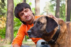 man and his dog - man's best friend - stock photo