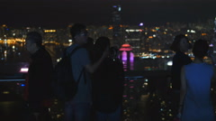 Lovers cuddle on Hong Kong Peak 4K Stock Footage