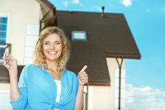 Happy girl with keys next to her new house Stock Photos