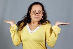 Puzzled woman, perplexity Stock Photos