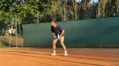 tennis player hitting backhand slow motion - stock footage
