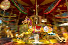 Motion blurr of vintage horse of amusement ride on merry-go-round carousel Kuvituskuvat
