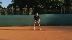 Tennis player hitting forehand celebrates point slow motion Stock Footage