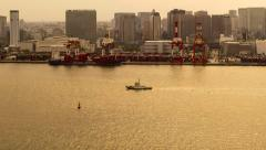 Time-lapse of ships in Tokyo Bay at sunset - stock footage