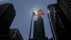 Detail of New York City with fluttering American flag - stock footage