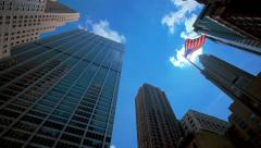NYC corporate buildings and American flag - stock footage