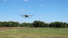 Plane makes landing field near the forest Stock Footage