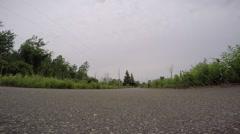 Supermoto crazy wheelie edit down low of motorcycle Stock Footage