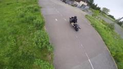 Aerial follow motorcycle crotch rocket on track (drone) Stock Footage