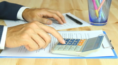 Businessman Calculating by Use Finger Press Calculator to Solve Problem Stock Footage