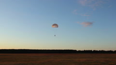 Paratrooper comes down to earth Stock Footage