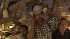 Honduran farmer on bus on phone Stock Footage