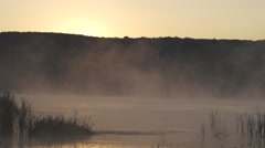 Morning mists rise rapidly over the lake.Sunrise over the mountain-timelapse Stock Footage