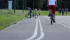 Bike path ride cyclists and skaters Stock Footage