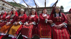 Old womens dressed in old Bulgarian folklore clothing sitting on the bench Stock Footage