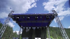 raising the music scene in the mountains with the background moving clouds - stock footage