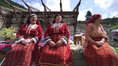 three old women dressed in old Bulgarian folklore clothing - stock footage