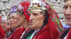 The faces of old women dressed in old Bulgarian folklore clothing Stock Footage