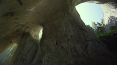 Hurrying shadows in a cave run on a large scale open to the sky-timelapse Stock Footage