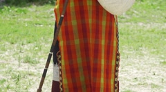 Bulgarian folk dressed in costume playing the bagpipe Stock Footage