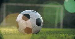 Kicking a Football Soccer Close Up Stock Footage