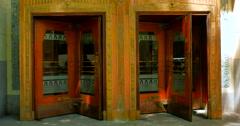 4K Pair of Revolving Doors in Old Building, Downtown City Metropolis Stock Footage