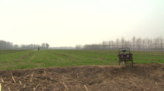 Rural China, Man tilling field Stock Footage