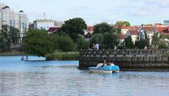 People floating on catamarans on the river city Stock Footage