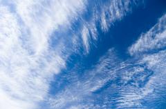 Cirrus and stratus clouds against blue sky background Stock Photos